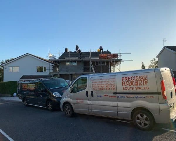 Precision Van in front of house with scaffolding