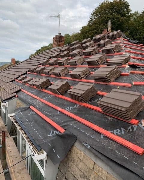 Roof tiles stacked on top of roof